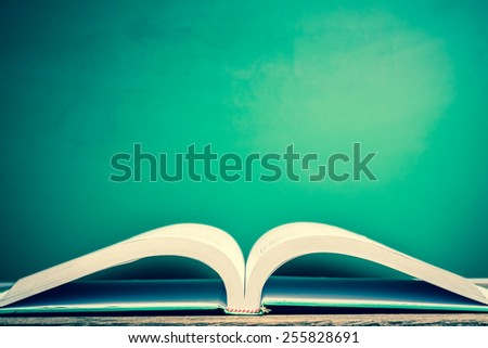 Text book with green board background, vintage tone  - stock photo