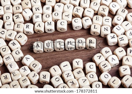 Text concept macro: Letter dices forming word author - stock photo