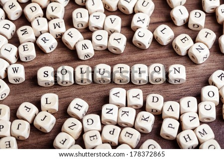 Text concept macro: Letter dices forming word solution - stock photo