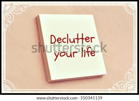 Text declutter your life on the short note texture background - stock photo