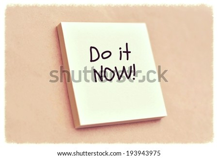 Text do it now on the short note texture background