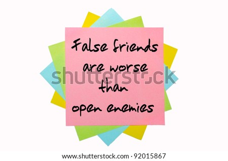 "text ""  False friends are worse than open enemies "" written by hand font on bunch of colored sticky notes"