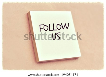 Text follow us on the short note texture background