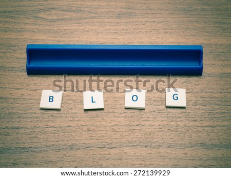 Text game tiles spelling the word blog. Conceptual image of social media communication. - stock photo