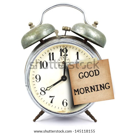 text good morning on vintage retro alarm clock and short note on white background - stock photo