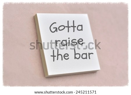 Text gotta raise the bar on the short note texture background - stock photo