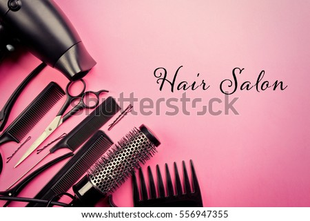 Text HAIR SALON and barber equipment on color background