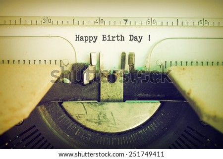 text  Happy birth day  on the vintage typewriter in vintage color - stock photo