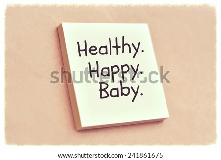 Text healthy happy baby on the short note texture background - stock photo