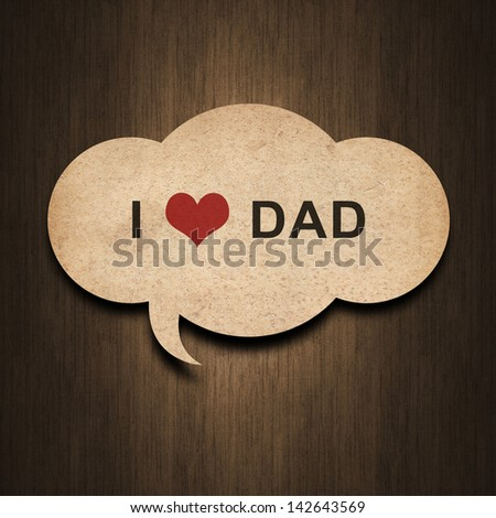 text i love dad on speech bubble paper on wood background - stock photo