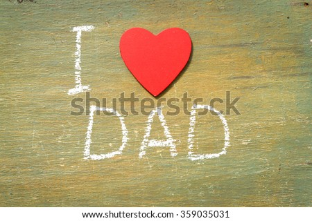 Text i love dad written with chalk in old board wooden. - stock photo