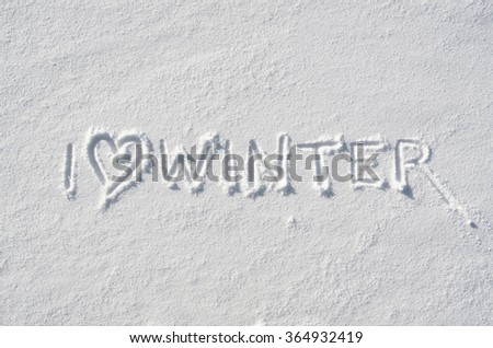 Text I LOVE WINTER and heart symbol hand written on snow background. Horizontal postcard template. - stock photo