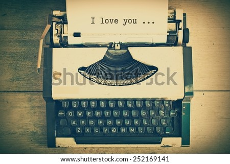 text I love you on the paper in vintage typewriter vintage color tone - stock photo