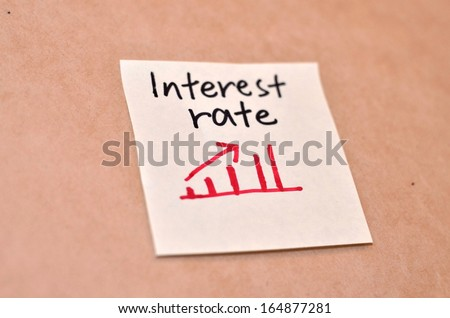 Text interest rate on the short note texture background - stock photo