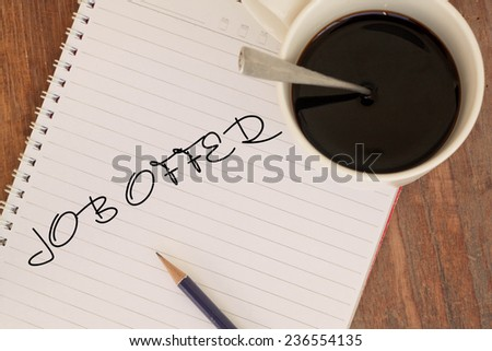 Text job offer on book and coffee  - stock photo