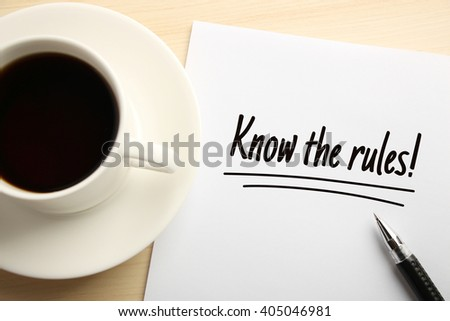 Text Know The Rules written on the white paper with coffee aside. - stock photo