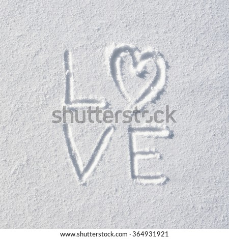 Text LOVE and heart hand written on snow background. Square valentines postcard template. - stock photo