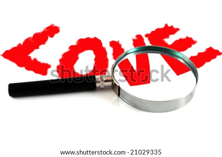Text â??LOVEâ? and magnifying glass isolated on white background - stock photo
