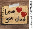 Text love you Dad for father's day  with  red heart on short note vintage paper with tape on the old wood wall background - stock photo