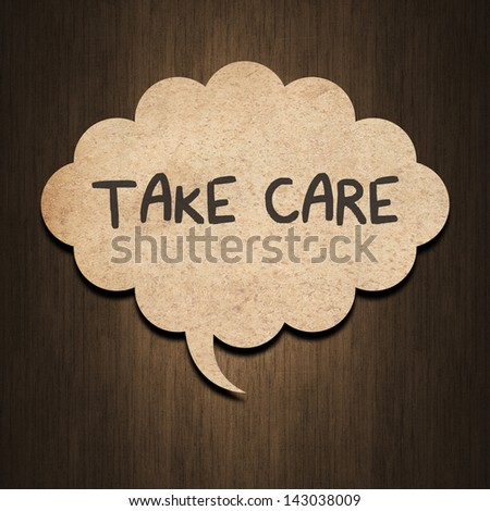 text love you on speech bubble paper on wood background - stock photo