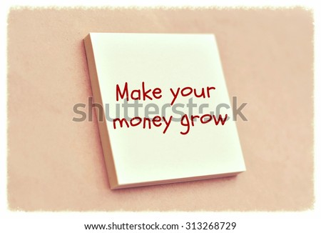 Text make your money grow on the short note texture background - stock photo