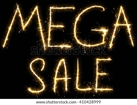 Text Mega sale  made by sparkler. Isolated on a black background