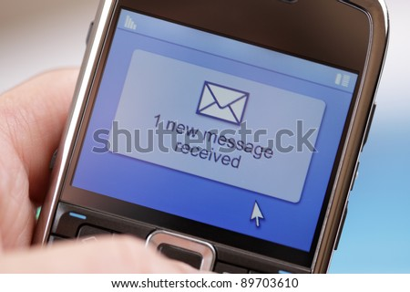 Text message received on a mobile phone - stock photo
