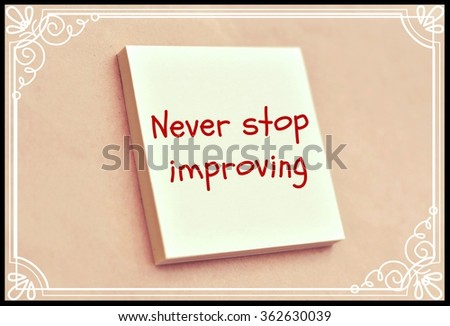 Text never stop improving on the short note texture background - stock photo