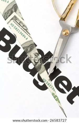 text of Budget and scissors, concept of Budget cut