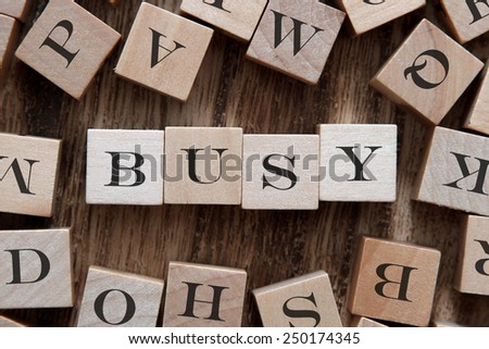 text of BUSY on cubes - stock photo