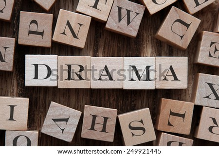 text of DRAMA on cubes - stock photo