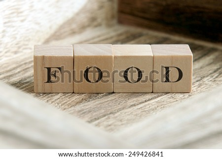 text of FOOD on wooden cubes