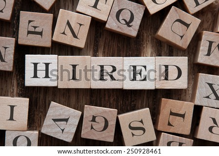 text of HIRED on cubes - stock photo