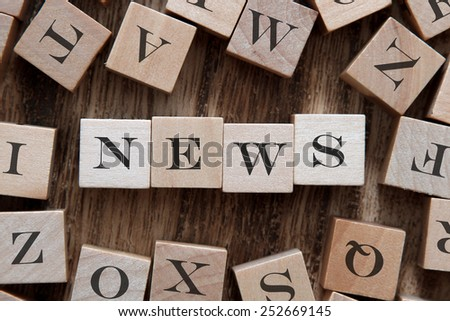 text of NEWS on cubes - stock photo