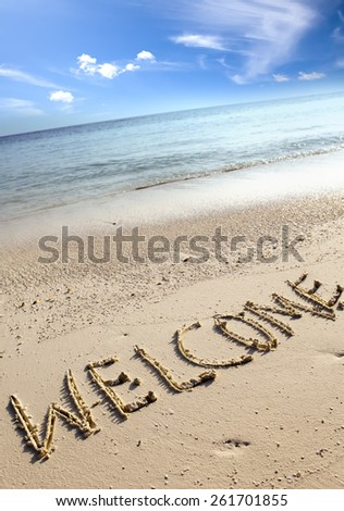 text on sand - welcome - stock photo
