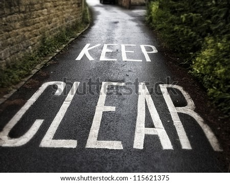 Text on the road in a little Town in the Southwestern part of England. - stock photo