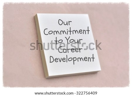 Text our commitment to your career development on the short note texture background - stock photo