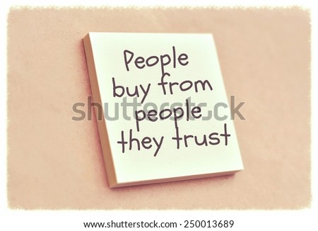 Text people buy from people they trust on the short note texture background - stock photo
