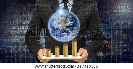 Text Portrait effect of Businessman holding the tablet with earth and stack of golden coins on Trading graph on the cityscape at night and world map background,Elements of this image furnished by NASA - stock photo