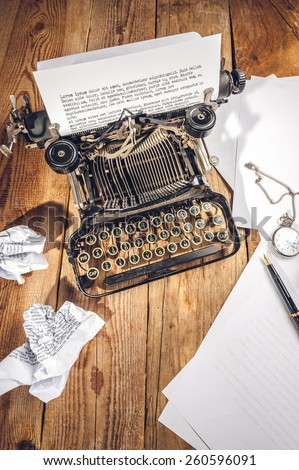 Text prescribed on a vintage typewriter and watch timekeeper. - stock photo