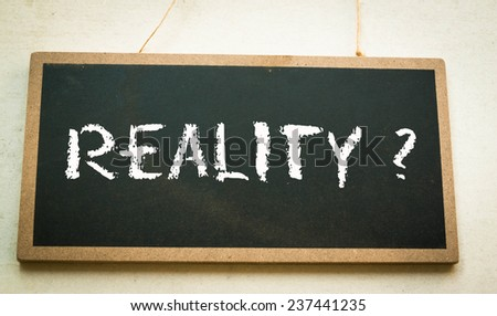 Text reality concept on board  - stock photo