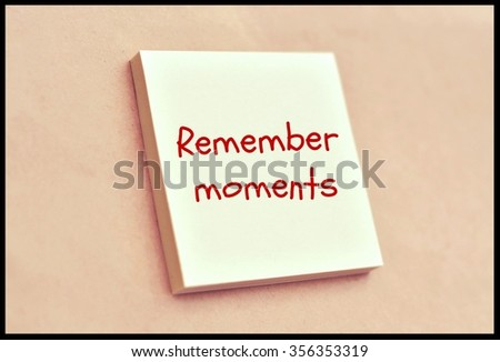 Text remember moments on the short note texture background - stock photo
