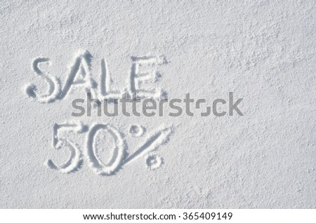 Text SALE 50 % hand written on snow background. Horizontal postcard template. Space for copy, lettering. - stock photo
