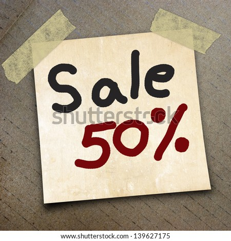 text sale 50%   write on  paper on the packing paper box texture background