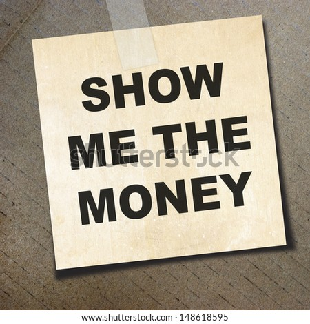 text show me the money on short note paper on the packing paper background - stock photo