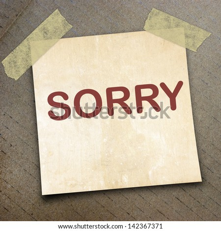 text sorry on short note paper on the packing paper box texture background