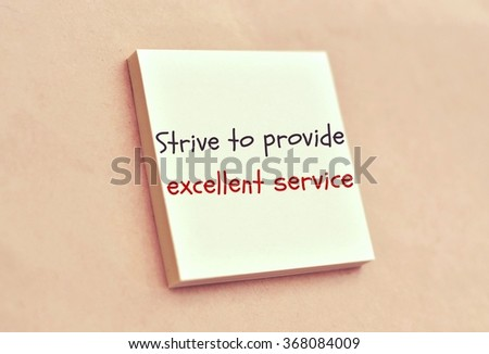 Text strive to provide excellent service on the short note texture background - stock photo