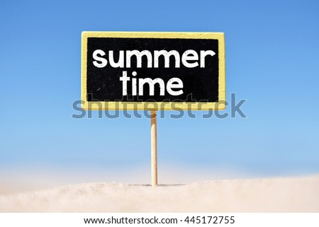 Text Summer time written with chalk on chalkboard. Text Summer time written with chalk on chalkboard, on sandy beach side