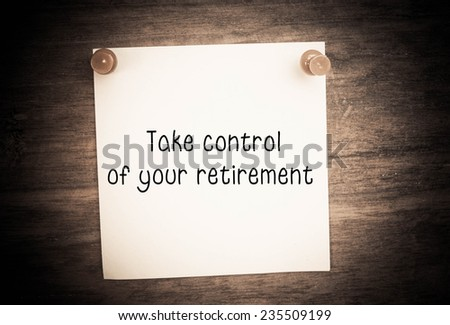 Text take control of your retirement on note paper  - stock photo