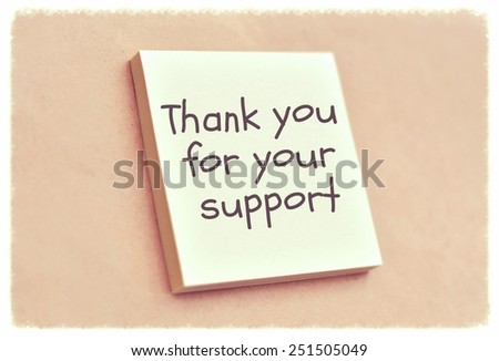 Text thank you for your support on the short note texture background - stock photo